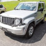 Jeep with front bumper damage