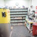 shelf of auto paints and sprayers