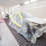 car covered in plastic ready for paint