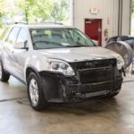 Car with damage before repair
